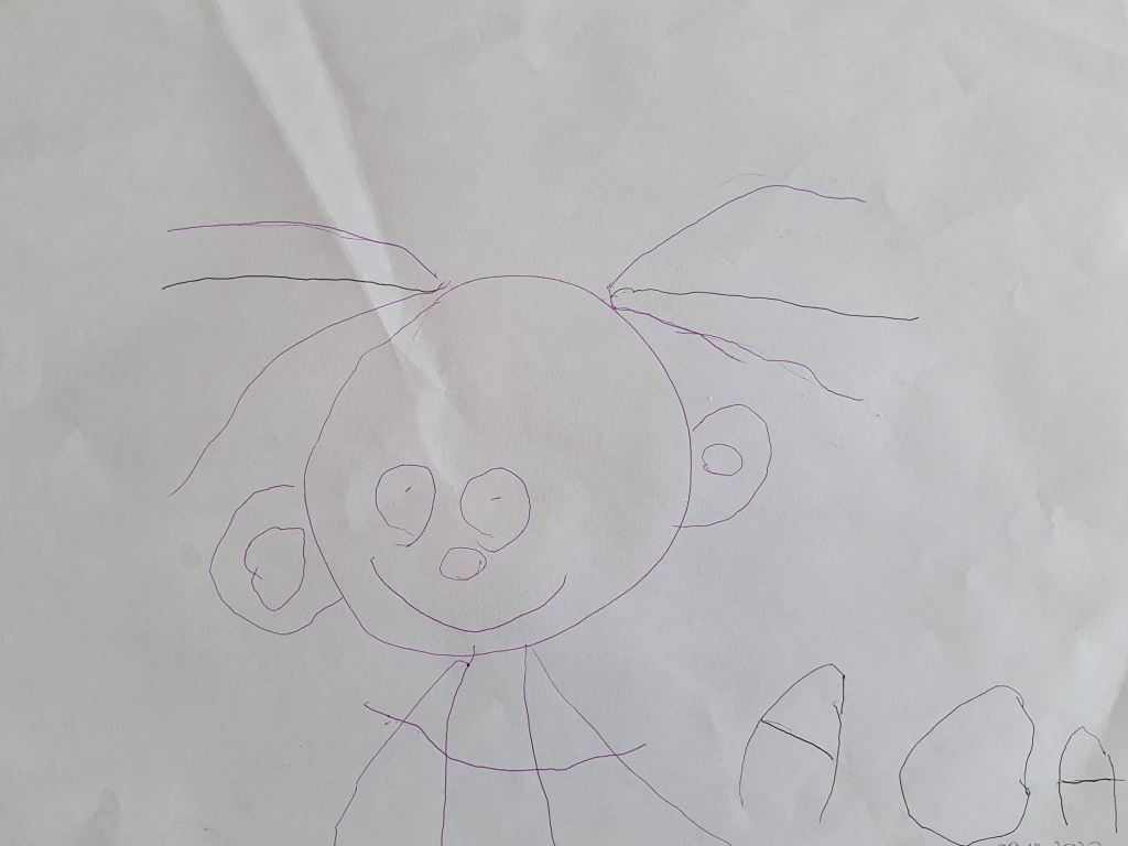 Pictured is a self-portrait drawing by Ada  / Ada's story