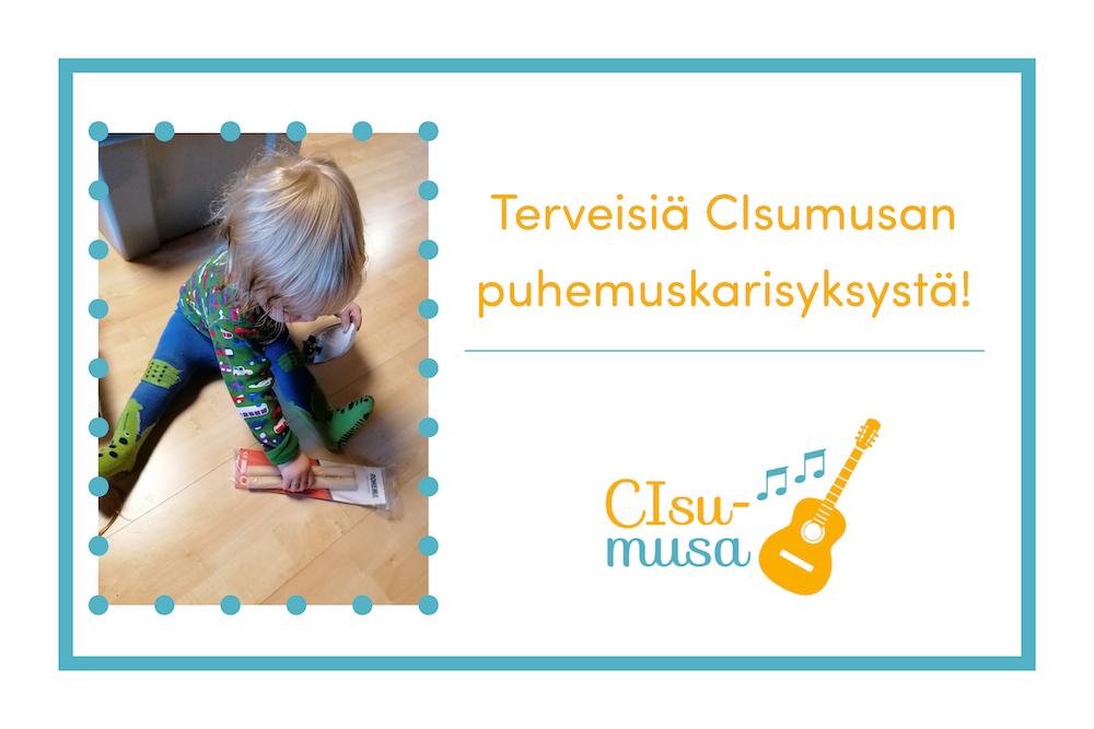 Kuvassa lapsi leikkii musiikkikapuloilla